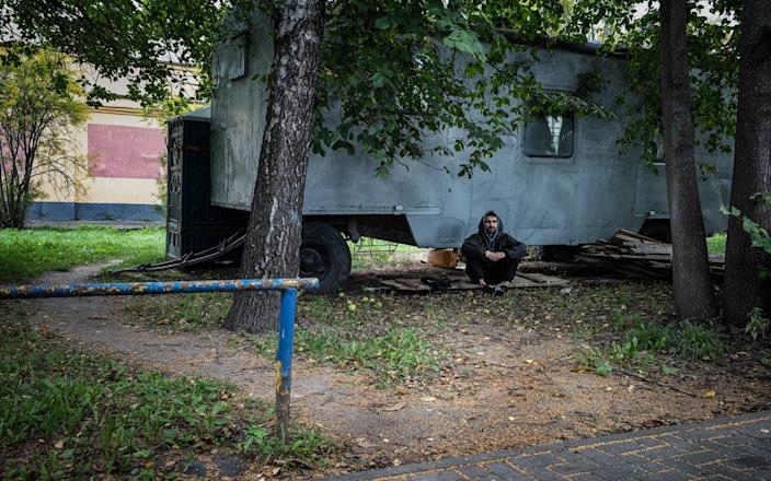 Belarusian web developer Andrey Fedorovich found himself underneath an abandoned van for an hour while riot police were chasing protesters across Minsk on the election night on Aug 9 - Misha Friedman