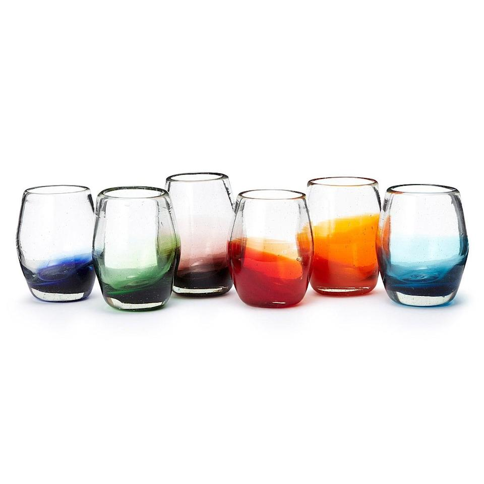 <p>Made from recycled glass, the <span>Multicolor Ombré Stemless Wine Glass Set</span> ($85) lends a beautiful style wherever they're placed.</p>
