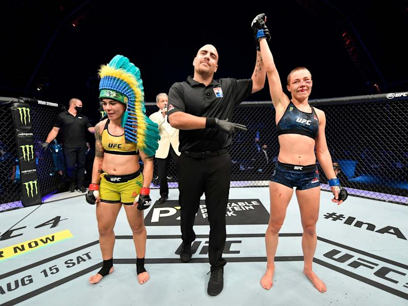 Rose Namajunas, right, is awarded victory over Jessica Andrade: Getty