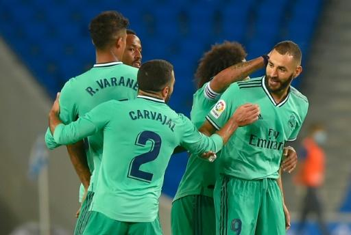 Karim Benzema (R) celebrates with his Real Madrid teammates after scoring in Sunday's 2-1 win at Real Sociedad which put them back in command in the Spanish title race