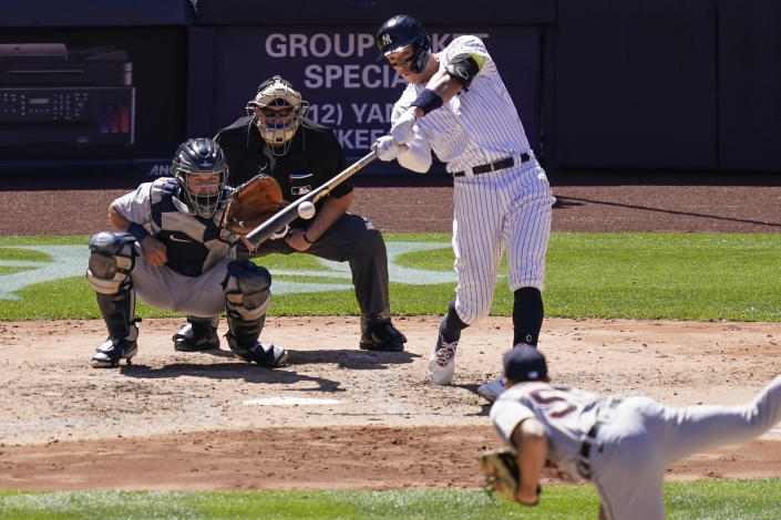 New York Yankees' Aaron Judge hits an RBI single off Detroit Tigers starting pitcher Spencer Turnbull, foreground, in the fifth inning of a baseball game, Saturday, May 1, 2021, in New York. (AP Photo/John Minchillo)