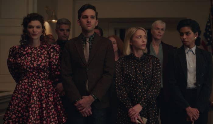 Wendy wears a floral dress, Jordan wears a full suit and tie, Kate wears a polka dot dress, and Rema wears a paint suit