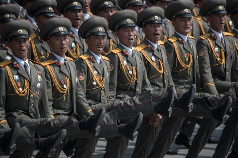 Ggoose-stepping soldiers pour into Kim Il-Sung Square, in Pyongyang on April 15, 2017