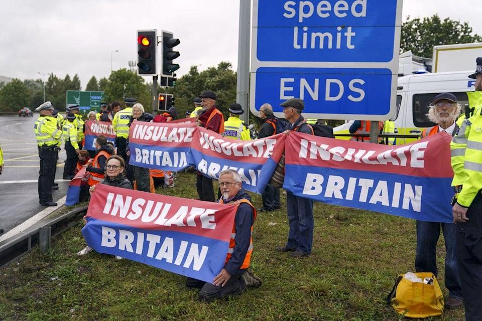 Members of Insulate Britain occupying a roundabout leading from the M25 motorway to Heathrow Airport in London (Steve Parsons/PA) (PA Wire)