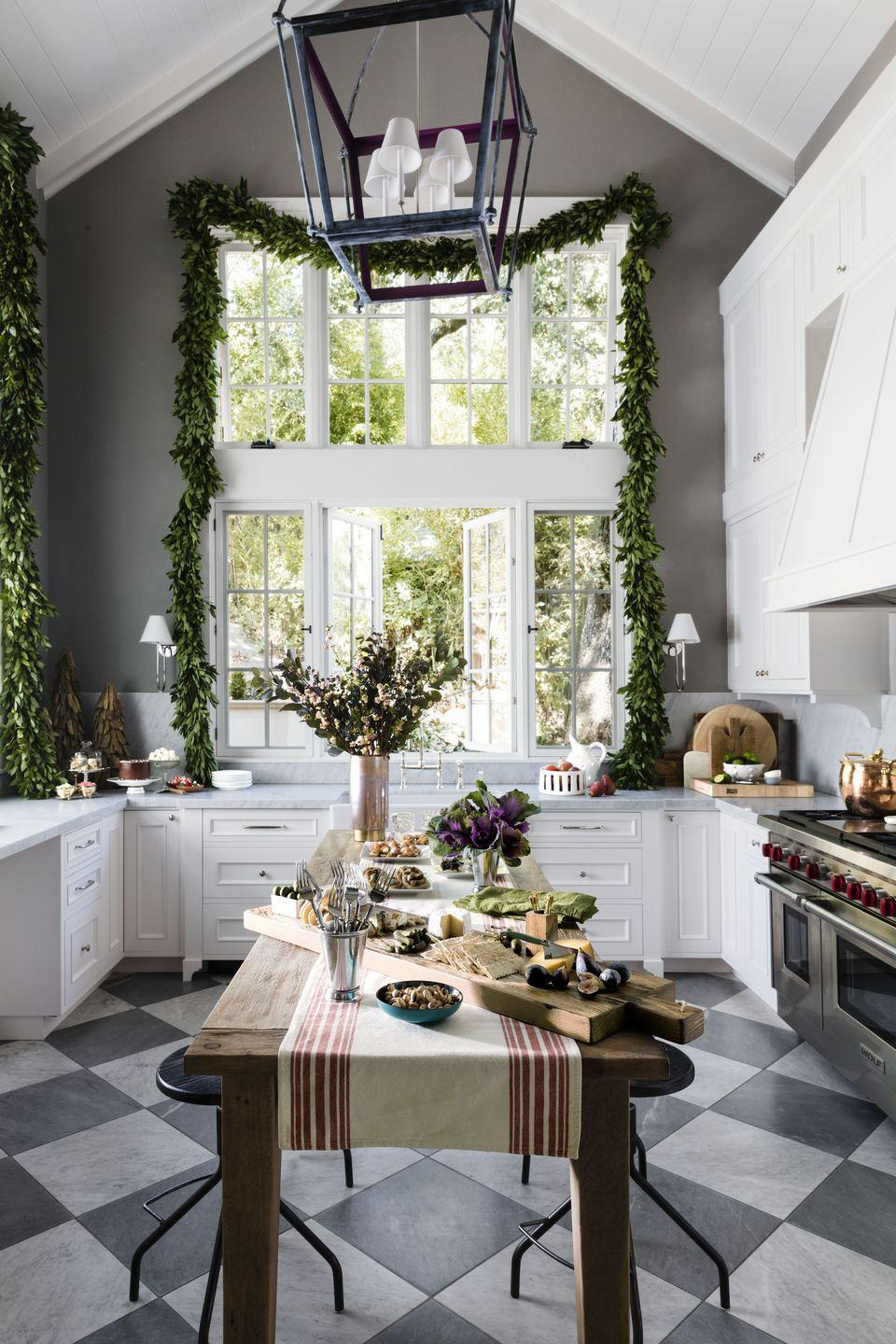 <p>Have giant windows? Think how amazing they'll look with a garland draped over them.</p>