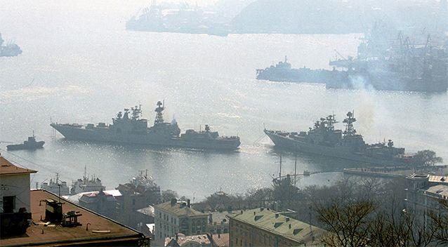 Russian Navy ships Admiral Panteleyev, left, and Marshal Shaposhnikov, right, two anti-submarine ships with the Pacific Fleet, leave Vladivostok harbour in the Russian Far East, to head to the Indian Ocean. Photo: AP, file