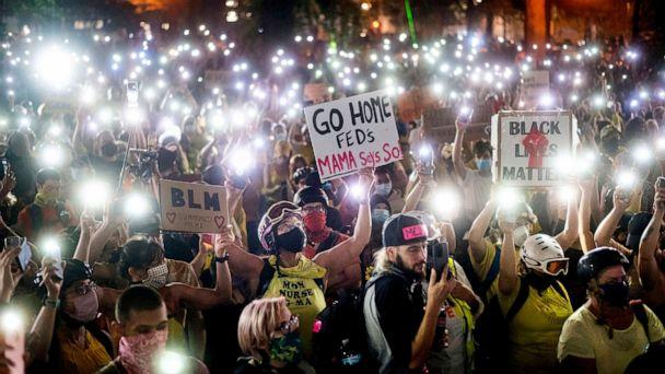 PHOTO: Hundreds of protesters hold their phones aloft in Portland, Ore., July 20, 2020. (Noah Berger/AP, FILE)