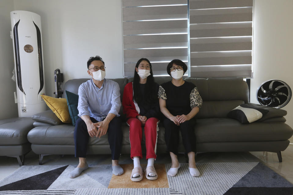 "Ma Seo-bin, center, a high school senior at an elite, speaks in between her father Ma Moon Young, left, and mother Choi Hae-jeong during an interview at their home in Siheung, South Korea, on Sept. 19, 2020. ""I felt I was trapped at the same place and I got lots of psychological stress,"" said daughter Ma. When South Korea began its delayed school year with remote learning in April, that spelled trouble for low-income students who rely on public education, get easily distracted and cannot afford private schools or tutors used by many in this education-obsessed country. (AP Photo/Ahn Young-joon)"