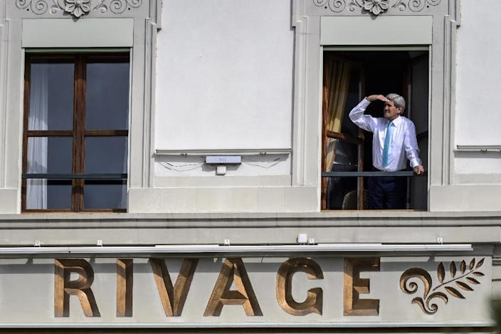 US Secretary of State John Kerry looks out of the window of his room at the Beau-Rivage Palace hotel during a break in Iran nuclear talks in Lausanne, Switzerland, on April 1, 2015 (AFP Photo/Fabrice Coffrini )