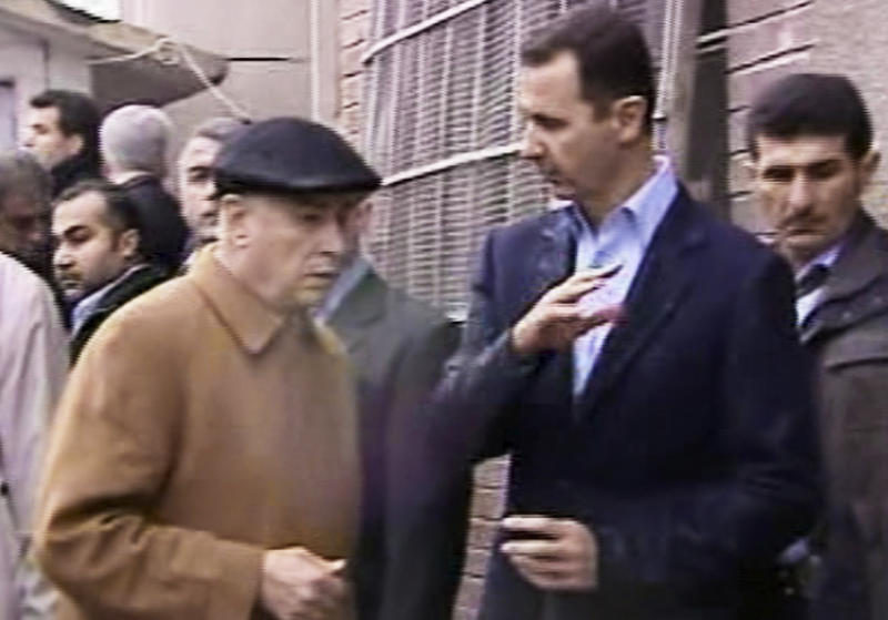 In this image made from video, Syrian President Bashar Assad, second right, visits Baba Amr neighborhood in Homs, Syria, Tuesday, March 27, 2012. Assad visited Baba Amr, a former rebel stronghold in the key city of Homs that became a symbol of the uprising after a monthlong siege by government forces killed hundreds of people many of them civilians as troops pushed out rebel fighters. Homs has been one of the cities hardest hit by the government crackdown on the uprising that began last March. (AP Photo/Syrian State Television via APTN) SYRIA OUT TV OUT