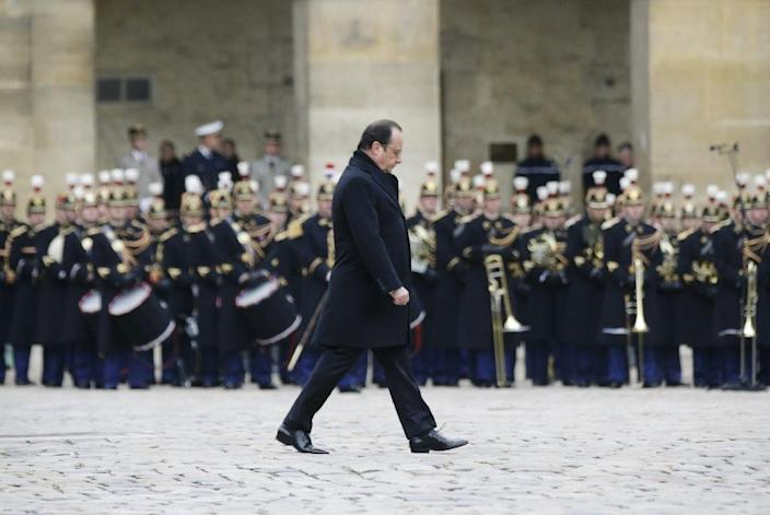 French President Francois Hollande arrives to lead a solemn ceremony on November 27, 2015 for the National Tribute to the 130 people killed during Paris attacks earlier in the month (AFP Photo/Philippe Wojazer)