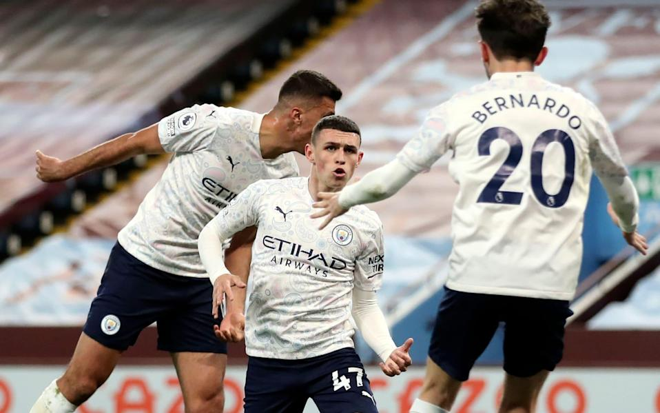 Manchester City's Phil Foden (C) celebrates with teammates after scoring the 1-1 equalizing goal during the English Premier League soccer match between Aston Villa and Manchester City in Birmingham, Britain, 21 April 2021. Aston Villa vs Manchester City, Birmingham - Carl Recine/POOL/EPA-EFE/Shutterstock
