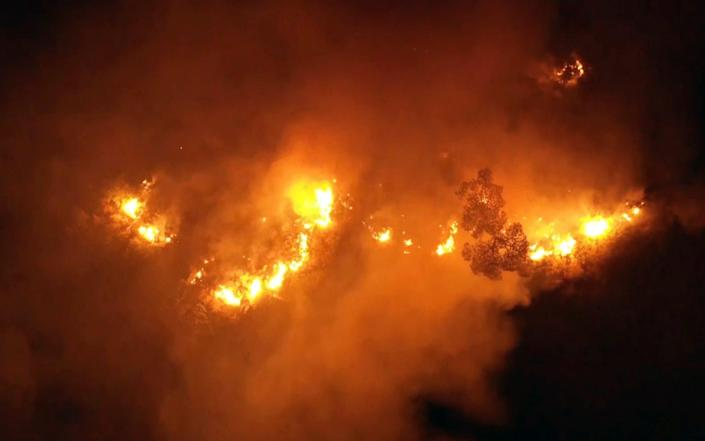 Flames rise at the scene of forest fire in Ras el-Harf village, in the Baabda district, Lebanon - -/AP