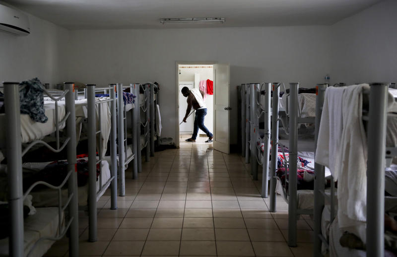 "A migrant from Cameroon cleans the floor of ""La Casa del Migrante"" shelter for migrants in Matamoros, Mexico, Thursday, Aug. 1, 2019, on the border with Brownsville, Texas. The United States government has sent some 800 mostly Central American and Cuban immigrants back to this northern Mexico border city since expanding its controversial plan to this easternmost point on the shared border two weeks ago, according to local Mexican authorities. (AP Photo/Emilio Espejel)"