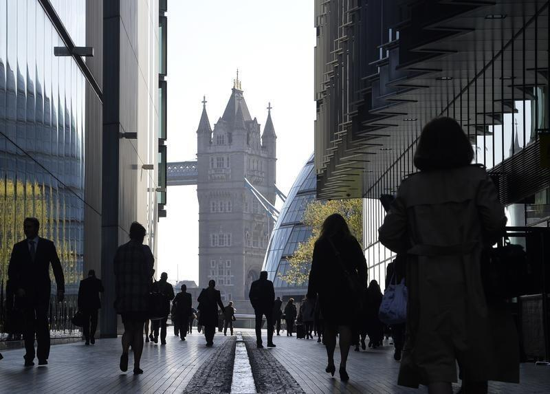 City workers head to work during the morning rush hour in London