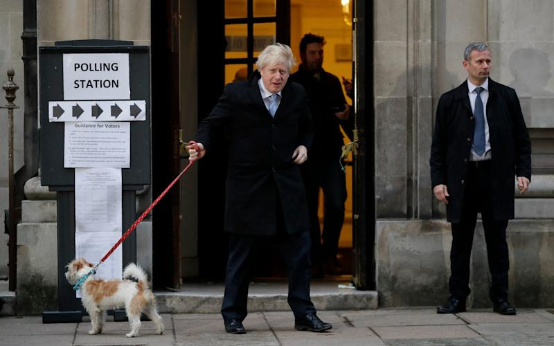 The PM casts his vote in Westminster...with a little help from a friend. - AP