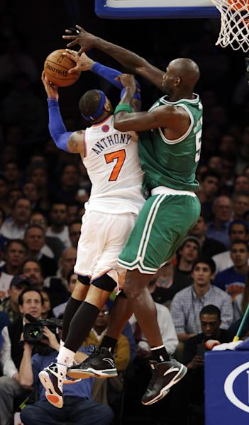 Boston Celtics forward Kevin Garnett (5) blocks a shot by New York Knicks forward Carmelo Anthony (7) in the second half of their NBA basketball game at Madison Square Garden in New York, Monday, Jan. 7, 2013. The Celtics won 102-96. (AP Photo/Kathy Willens)