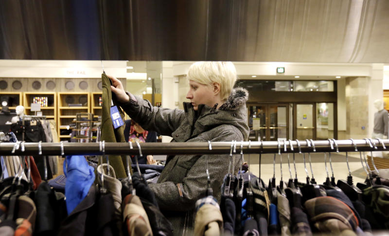 FILE - In this Thursday, Jan. 10, 2013 file photo, a woman shops at a Nordstrom store in Chicago. U.S. consumers increased spending modestly in January but cut back on major purchases that signal confidence in the economy. (AP Photo/Nam Y. Huh, File)