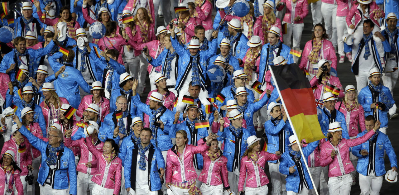 Germany's Natascha Keller carries the flag during the Opening Ceremony at the 2012 Summer Olympics, Friday, July 27, 2012, in London. (AP Photo/Paul Sancya)