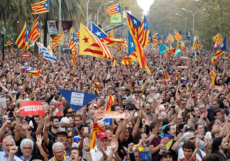 People celebrate in Barcelona after the Catalan regional Parliament there voted for independence from Spain on Friday.