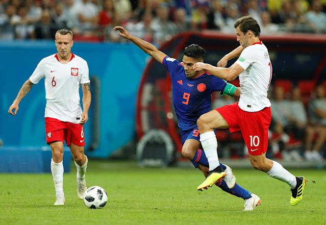 Soccer Football - World Cup - Group H - Poland vs Colombia - Kazan Arena, Kazan, Russia - June 24, 2018 Colombia's Radamel Falcao in action with Poland's Grzegorz Krychowiak REUTERS/John Sibley
