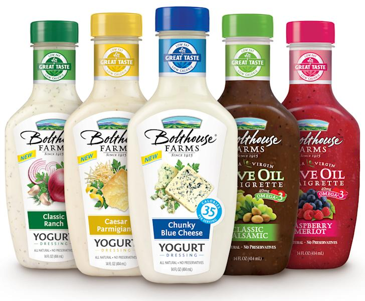 This undated handout image provided by Campbell Soup. Co. shows bottles of Bolthouse Farms salad dressings. Campbell Soup Co., said Monday, July 9, 2012, that it will buy natural foods maker Bolthouse Farms in a $1.55 billion cash deal from private equity firm Madison Dearborn Partners LLC. Campbell says Bolthouse's line of juices and carrots will help it feed Americans' growing appetite for fresher foods. (AP Photo/Campbell Soup)
