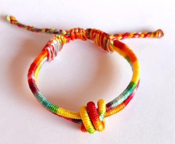 "<p>""Created by designer and activist Ariela Suster, Sequence is working to disrupt the cycle of violence in El Salvador. Suster's rainbow collection is a symbol to always keep your heart and mind open, free of judgment for yourself and others. You can spread the sentiment with the <span>Rainbow Knot Bracelet</span> ($25)."" - DAC</p>"