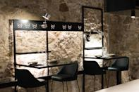 """<p><strong>Tell us about your first impressions when you arrived.</strong> Slow & Low's décor, from Sánchez Guisado Arquitectos, the tastemakers behind <a href=""""https://www.cntraveler.com/restaurants/barcelona/tickets-bar?mbid=synd_yahoo_rss"""" rel=""""nofollow noopener"""" target=""""_blank"""" data-ylk=""""slk:Tickets"""" class=""""link rapid-noclick-resp"""">Tickets</a> and <a href=""""https://www.cntraveler.com/restaurants/barcelona/enigma?mbid=synd_yahoo_rss"""" rel=""""nofollow noopener"""" target=""""_blank"""" data-ylk=""""slk:Enigma"""" class=""""link rapid-noclick-resp"""">Enigma</a>, is urban, young, and cool, with pink walls, deep green metro tiles, tables suspended from hanging iron wall shelves.</p> <p><strong>What's the vibe like?</strong> Everyone's making a beeline for the six stools at the kitchen counter, which are positioned at the same height as the chefs—a metaphor, perhaps, to the restaurant's ethos: take everything you traditionally associate with tasting menus and stick a finger up at it. You can wear whatever, talk about whatever. The only rule is that you eat well.</p> <p><strong>What's the drink situation?</strong> The longer of the two tasting menus kicks off with a cocktail. There are also wine pairings.</p> <p><strong>How's the food?</strong> Head chef Francesc Beltri spent time traveling and living in <a href=""""https://www.cntraveler.com/destinations/bali?mbid=synd_yahoo_rss"""" rel=""""nofollow noopener"""" target=""""_blank"""" data-ylk=""""slk:Bali"""" class=""""link rapid-noclick-resp"""">Bali</a> and <a href=""""https://www.cntraveler.com/destinations/singapore?mbid=synd_yahoo_rss"""" rel=""""nofollow noopener"""" target=""""_blank"""" data-ylk=""""slk:Singapore"""" class=""""link rapid-noclick-resp"""">Singapore</a>, and brings those influences into the kitchen here, along with Mexican, Mediterranean, and Peruvian flavors. If that all sounds a bit curious—well, that's the point. Dinner will be full of risks, whack-you-in-the-mouth flavors, and beautiful raw materials—sea urchins, Menorcan prawns, sirloin steak from Galicia. There isn't a wh"""