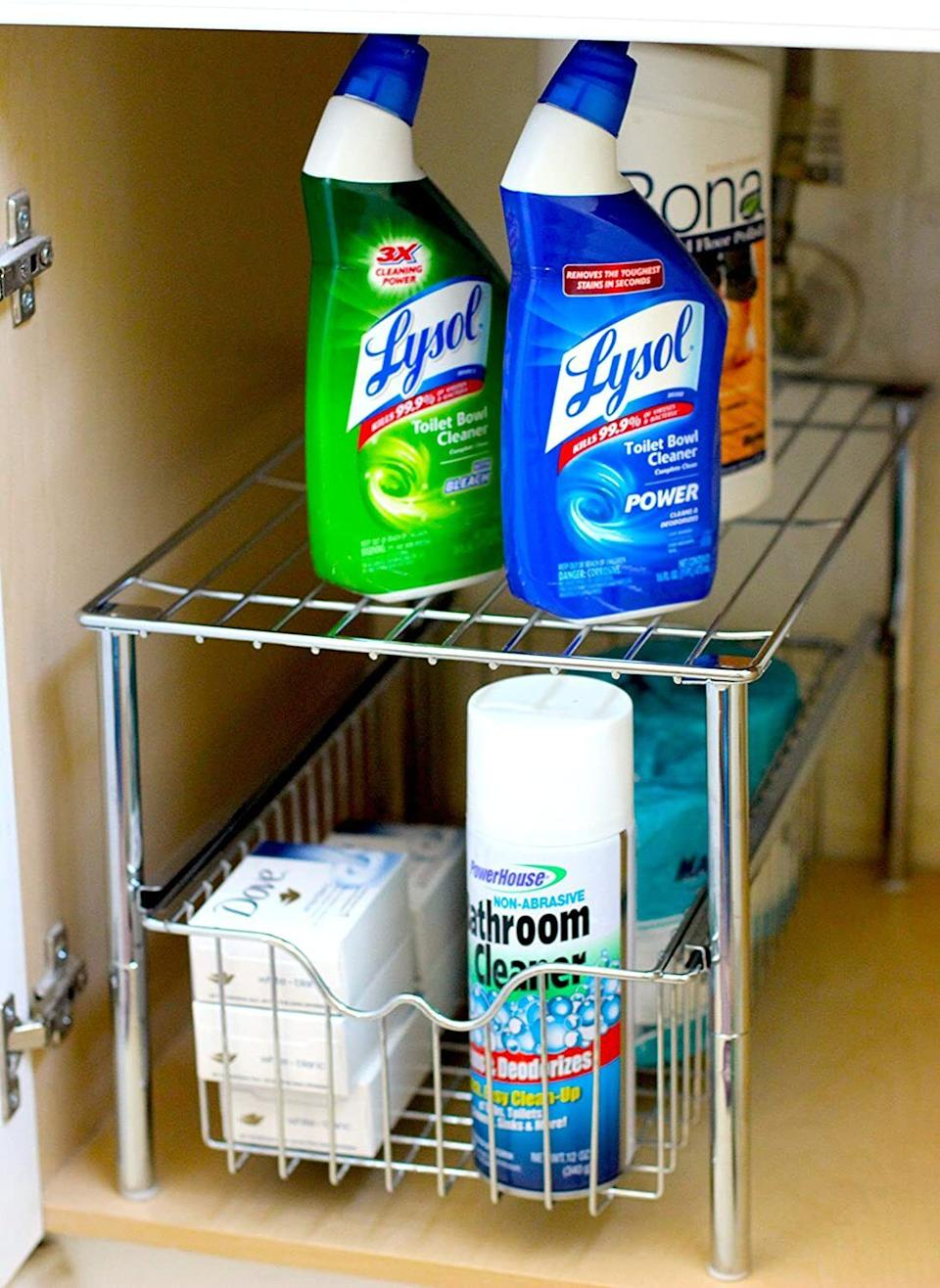 """Designed with a shelf on top, this drawer will help maximize space in your cleaning cupboard.<br /><br /><strong>Promising review:</strong>""""These are nice pieces that helped me organize underneath my bathroom sink! They fit perfectly!<strong>After organizing everything, I was so surprised I had so much more room than I grabbed more items out of the linen closet to fill it up.</strong>I still have a lot of room left. I bought these based on the high ratings and they hold true. (This is Brad's wife.)"""" —<a href=""""https://www.amazon.com/dp/B00KV5NRHC?tag=huffpost-bfsyndication-20&ascsubtag=5834502%2C10%2C46%2Cd%2C0%2C0%2C0%2C962%3A1%3B901%3A2%3B900%3A2%3B974%3A3%3B975%3A2%3B982%3A2%2C16267131%2C0"""" target=""""_blank"""" rel=""""noopener noreferrer"""">Brad J. Leahy</a><br /><br /><strong>Get it on Amazon for<a href=""""https://www.amazon.com/dp/B00KV5NRHC?tag=huffpost-bfsyndication-20&ascsubtag=5834502%2C10%2C46%2Cd%2C0%2C0%2C0%2C962%3A1%3B901%3A2%3B900%3A2%3B974%3A3%3B975%3A2%3B982%3A2%2C16267131%2C0"""" target=""""_blank"""" rel=""""noopener noreferrer"""">$24.97+</a>(available in two colors).</strong>"""