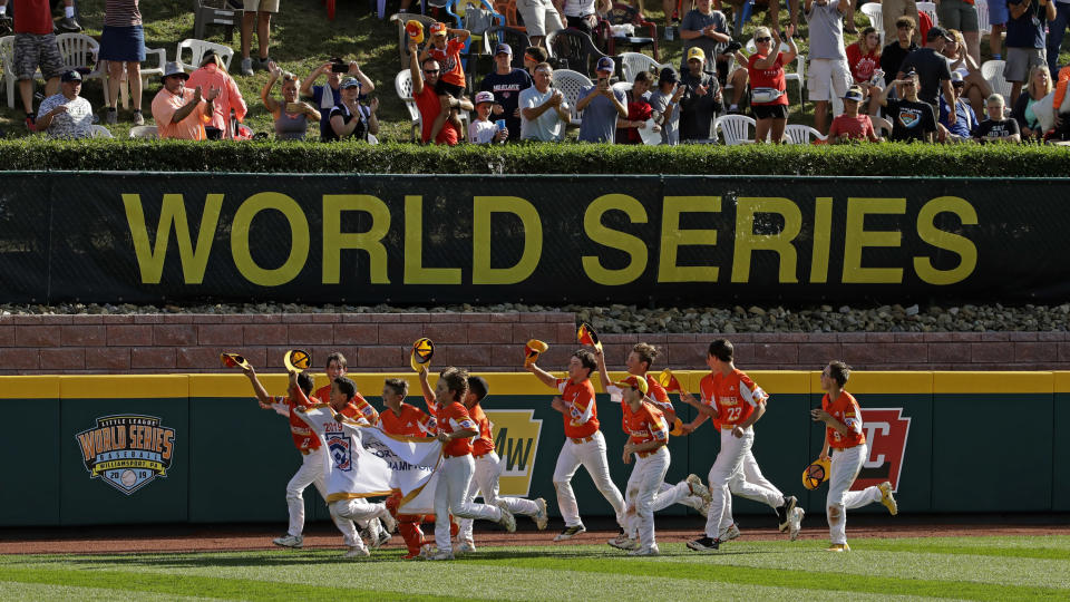 FILE - River Ridge, Louisiana takes a victory lap around the field at Lamade Stadium after winning the Little League World Series Championship game against Curacao, 8-0, in South Williamsport, Pa., in this Sunday, Aug. 25, 2019, file photo. The Little League World Series is planning to return in 2021 after last year's edition was canceled due to the COVID-19. (AP Photo/Gene J. Puskar, File)