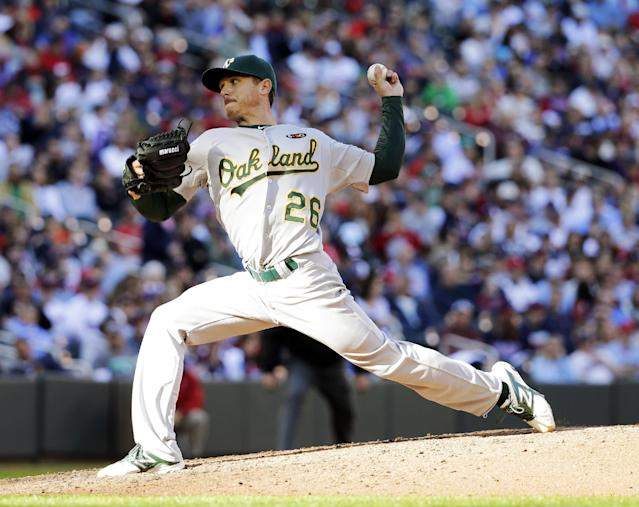 Oakland Athletics starting pitcher Scott Kazmir delivers to the Minnesota Twins during the sixth inning of a home opener baseball game in Minneapolis, Monday, April 7, 2014. (AP Photo/Ann Heisenfelt)