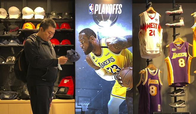A billboard featuring LA Lakers star Lebron James at an NBA store in Beijing. Photo: AP