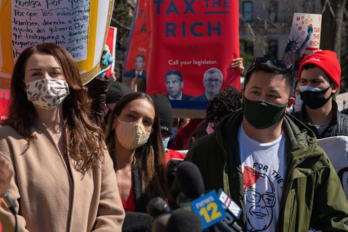 Lindsey Boylan became a vocal critic of the governorm demanding his resignation. She is pictured at a New York demonstration on March 20 (Getty Images)