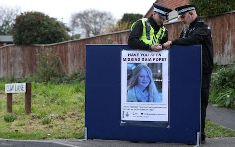 Police put up a missing person notice for Gaia Pope in Swanage - Credit: Andrew Matthews/PA