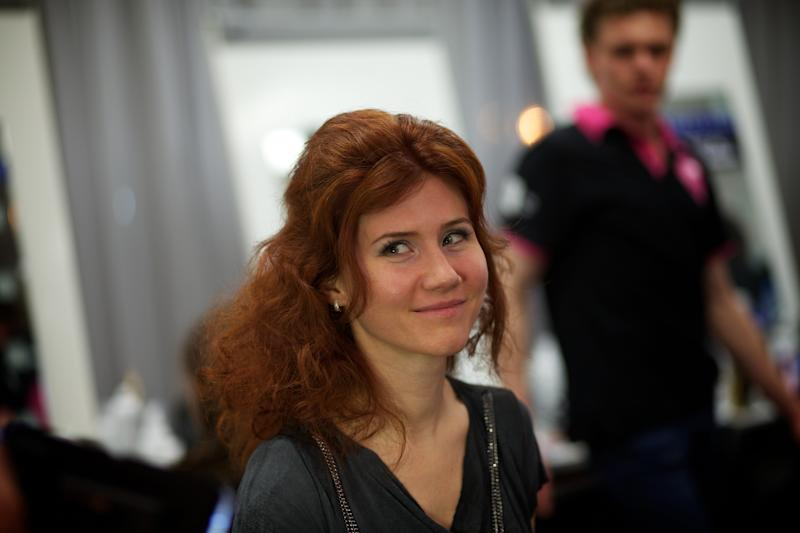 Russian Anna Chapman, who was deported from the U.S. on charges of espionage, smiles as she prepares to display a fashion creation by I Love Fashion, France, during the Fall-Winter 2012 - 2013 collection at Mercedes-Benz Fashion Week in Moscow, in this photo dated Thursday, March 22, 2012. Chapman was arrested in 2010 in USA on spying charges and was deported to Russia where she remains in the limelight. On Tuesday May 14, 2013, Russian security services announced they had detained a U.S. diplomat who they claim is a CIA official for allegedly trying to recruit a Russian agent. (AP Photo/Alexander Zemlianichenko)