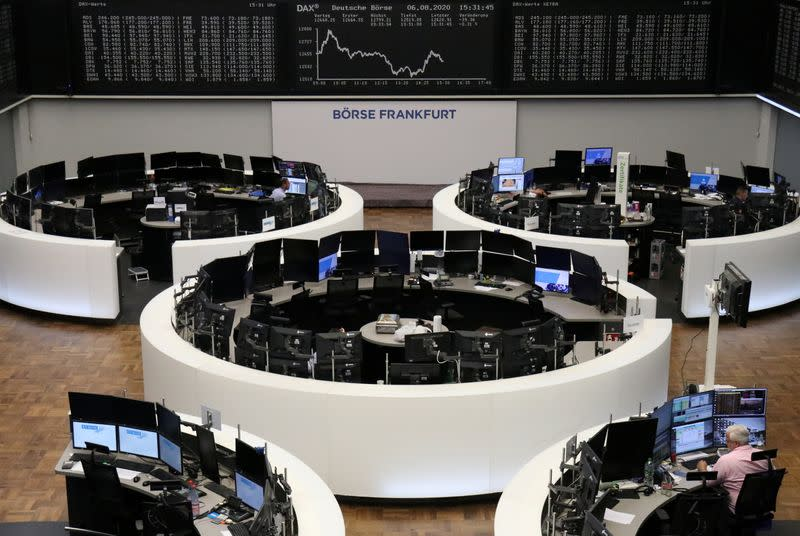 European stocks end lower as Fed boost offset by resource losses