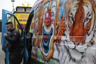 """A circus worker leaves his van during a protest Tuesday, Jan.26, 2021. French lawmakers start debating Tuesday a bill that would ban using wild animals in traveling circuses and keeping dolphins and whales in captivity in marine parks, amid other measures to better protect animal welfare. Circus workers stage a protest outside the National Assembly to denounce what they consider """"a mistake."""" (AP Photo/Lewis Joly)"""