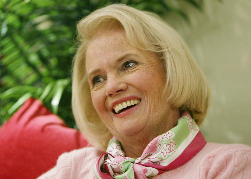 FILE -In this Thursday, April 15, 2004, file photo, Designer Lilly Pulitzer, smiles during an interview in her clothing company's Manhattan fashion district offices. Pulitzer, known for her tropical print dresses, died in Florida at 81 on Sunday, April, 7, 2013. (AP Photo/Kathy Willens)