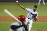 Miami Marlins' Sandy Alcantara pitches to Cincinnati Reds' Eugenio Suarez during the first inning of a baseball game, Wednesday, Aug. 28, 2019, in Miami. (AP Photo/Wilfredo Lee)