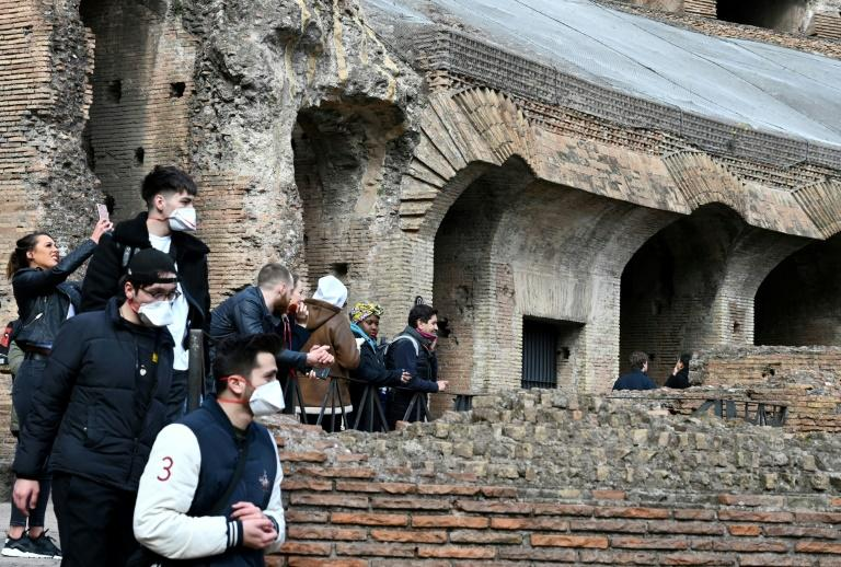 Tourists have Rome's Coliseum almost to themselves as the coronavirus outbreak keeps most people away