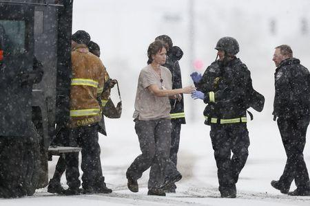 Police officers and fire department personnel lead people who were in a Planned Parenthood center out of an armored vehicle, after reports of an active shooter in Colorado Springs, Colorado November 27, 2015. REUTERS/Isaiah J. Downing