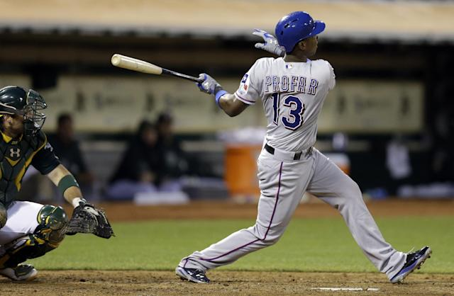 Texas Rangers' Jurickson Profar swings for a two-run home run off Oakland Athletics' Tommy Milone in the fourth inning of a baseball game Friday, Aug. 2, 2013, in Oakland, Calif. (AP Photo/Ben Margot)