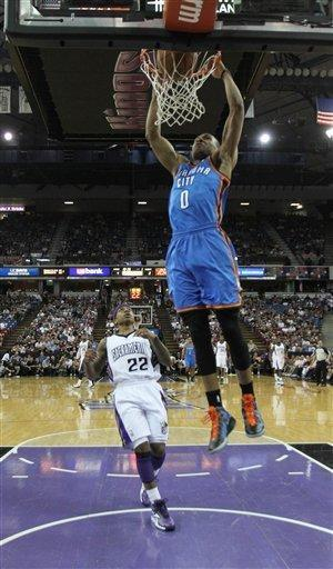 Oklahoma City Thunder guard Russell Westbrook, right, stuffs as Sacramento Kings guard Isaiah Thomas, left, looks on during the first quarter of an NBA basketball game in Sacramento, Calif., Friday, April 20, 2012. (AP Photo/Rich Pedroncelli)