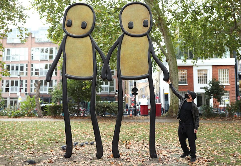 Stik at the launch of his 4-metre-high bronze sculpture