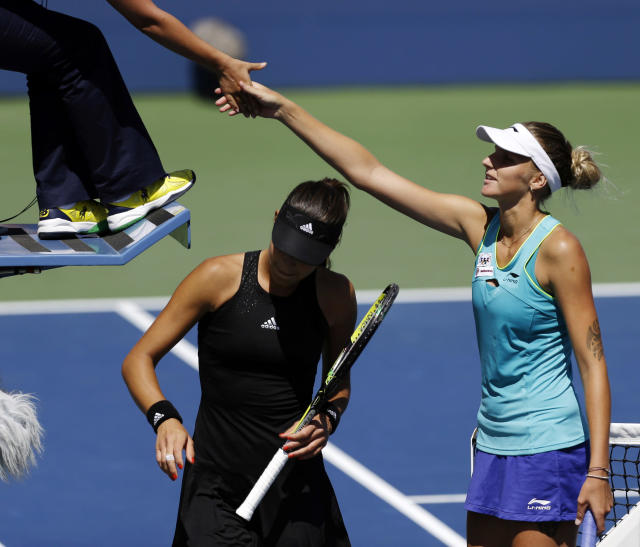 Kirolina Pliskova, of the Czech Republic, shakes hands with the umpire after defeating Ana Ivanovic, of Serbia, during the second round of the 2014 U.S. Open tennis tournament, Thursday, Aug. 28, 2014, in New York. (AP Photo/Frank Franklin II)