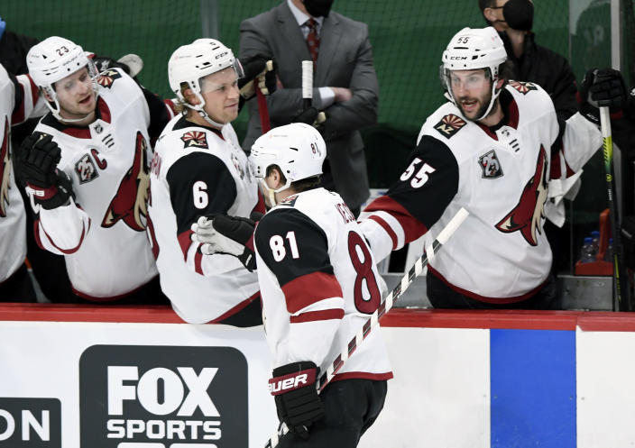 Arizona Coyotes' Oliver Ekman-Larsson (23), of Sweden, Jakob Chychrun (6) and Jason Demers (55) congratulate teammate right wing Phil Kessel (81) on his goal against the Minnesota Wild during the first period of an NHL hockey game Sunday, March 14, 2021, in St. Paul, Minn. (AP Photo/Hannah Foslien)