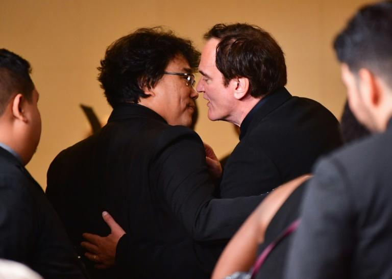 """Bong Joon-ho (L) speaks with director Quentin Tarantino at the Golden Globes -- the American once likened the South Korean filmmaker to to """"Steven Spielberg in his prime"""""""