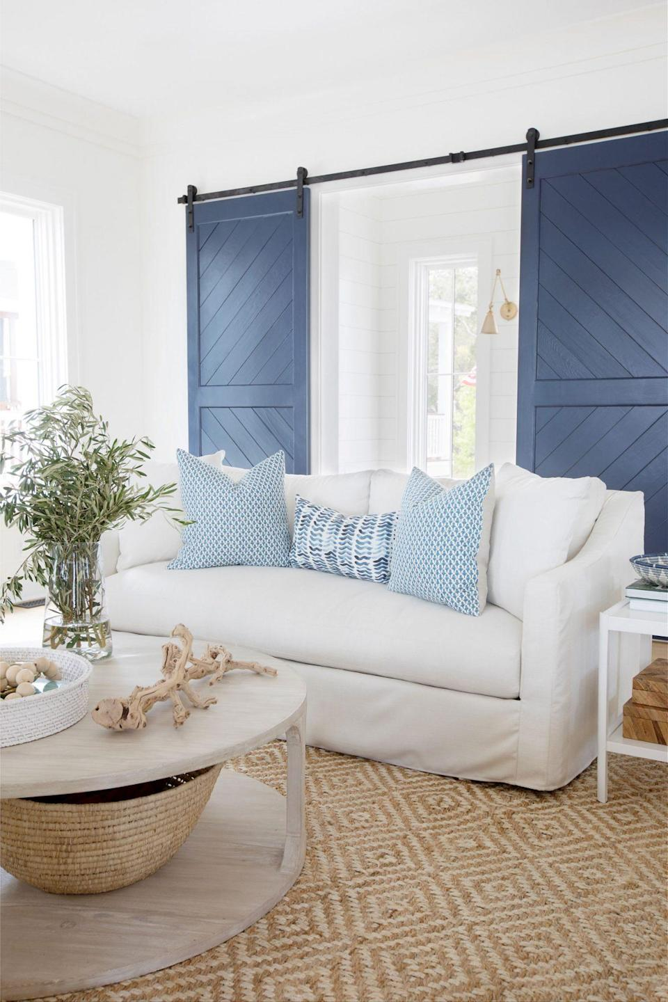 """<p>Charleston interior designer <a href=""""https://www.meganmolten.com"""" rel=""""nofollow noopener"""" target=""""_blank"""" data-ylk=""""slk:Megan Molten"""" class=""""link rapid-noclick-resp"""">Megan Molten</a> says her go-to paint color for making a room feel larger is Benjamin Moore's <a href=""""https://www.benjaminmoore.com/en-us/color-overview/find-your-color/color/oc-65/chantilly-lace?color=OC-65"""" rel=""""nofollow noopener"""" target=""""_blank"""" data-ylk=""""slk:Chantilly Lace"""" class=""""link rapid-noclick-resp"""">Chantilly Lace</a>. """"I've used it so much that it's become my signature shade. It's really just the perfect bright white—creating the ideal backdrop for that clean, coastal, and airy feel my clients are looking to achieve in their homes.""""</p>"""