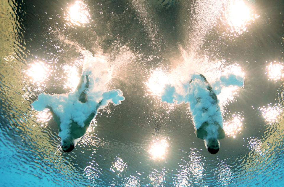 LONDON, ENGLAND - JULY 30: (L-R) Ivan Garcia Navarro and German Sanchez Sanchez of Mexico look on from the pool deck during the Men's Synchronised 10m Platform Diving on Day 3 of the London 2012 Olympic Games at the Aquatics Centre on July 30, 2012 in London, England. (Photo by Adam Pretty/Getty Images)