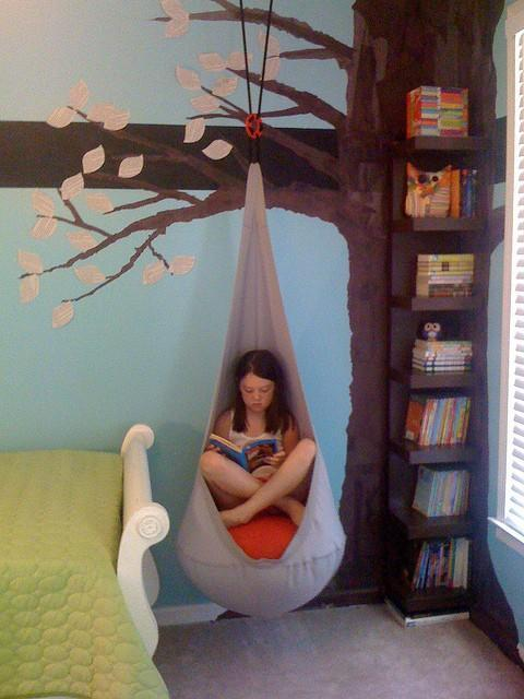"""<div class=""""caption-credit""""> Photo by: Flickr</div><div class=""""caption-title"""">Under the Tree</div>If there is a wall, paint it! I love this idea of trying to re-create the beautiful outdoors right here in a room. Choose a brown bookshelf, camouflage it as a tree trunk, paint away, and add a suspending chair to make this reading nook come to life! <br> <i><a rel=""""nofollow noopener"""" href=""""http://blogs.babble.com/family-style/2012/08/13/25-cute-and-cozy-kids-reading-nooks/#under-the-tree"""" target=""""_blank"""" data-ylk=""""slk:Get the inspiration here"""" class=""""link rapid-noclick-resp"""">Get the inspiration here</a></i> <br> <br> <b><i><span>For 17 more cool reading nook ideas, visit Babble!</span></i></b> <br>"""